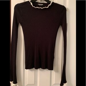 Black bell sleeved sweater with white piping